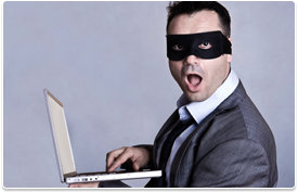 masked man on laptop